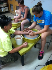 Students work clay wheels at the Banana Factory with artist, Deb Slahta