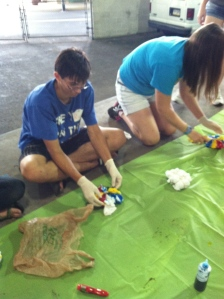 Student begin by tie-dyeing their own program T-shirt