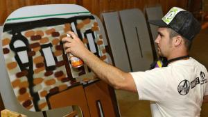 (Image by EMILY PAINE of the THE MORNING CALL) Max Meano of Bethlehem spray paints the first 'S' of a 'Welcome to Southside' mural he is working on at the Alternative Gallery in Allentown on Wednesday afternoon. The 'S' he is working on will depict a scene from Lehigh University. A Southside Bethlehem mural inspired by the 'Welcome to the Bronx' sign will be installed this month near the Comfort Suites in Bethlehem. The different letters will include images of Southside landmarks.